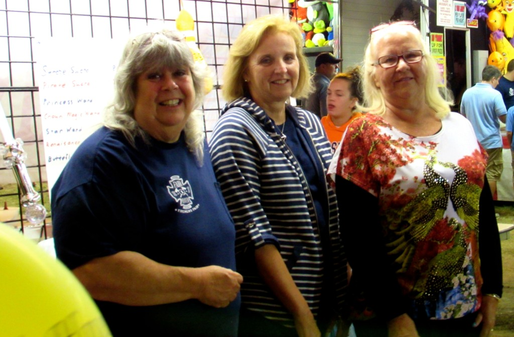 Some fair ladies of the Fair Haven Firemen's Fair at the Grab Bag Booth in 2014. Photo/Elaine Van Develde