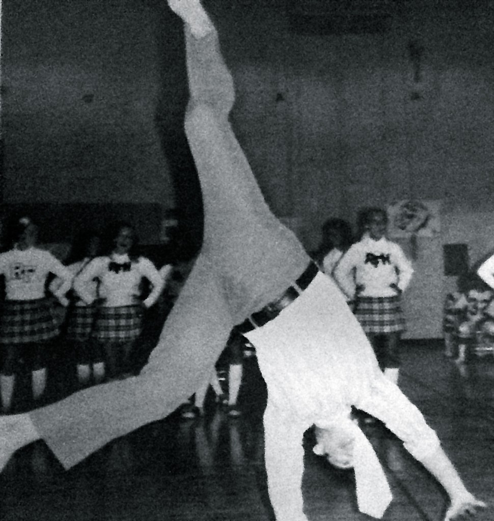 RFH teacher George Giffin does a cartwheel to cheer on the cheerleaders in the 1970s. Photo/RFH yearbook screenshot