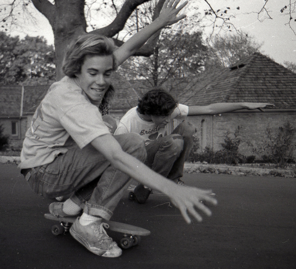 Mike Grady and A.J. Bruder skateboarding into spring circa 1970s Photo/George Day