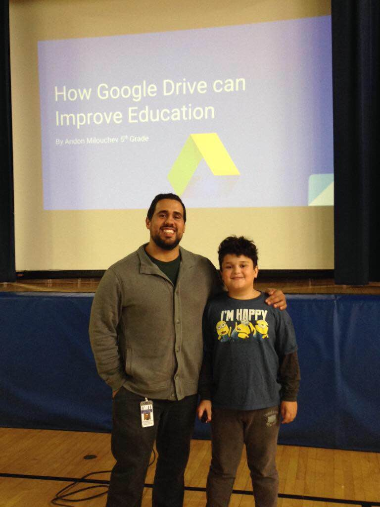 Knollwood School fifth-grader Andon Milouchev and Fair Haven School District EdTech Coach Chris Aviles prepare to make Google presentations to parents. Photo/Fair Haven School District